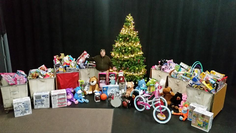 Ben Jumper (Owner) with Toy Donations.